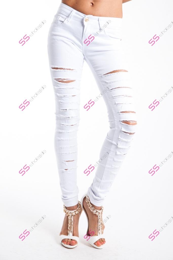7a21cb740381 Elastické roztrhané biele riflové nohavice